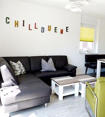 Das gemütliche Wohnzimmer in der Ferienwohnung Chilldüne Borkum